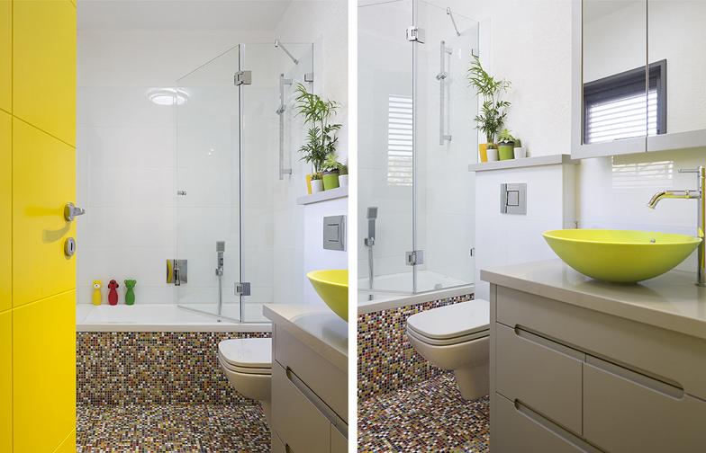 צילום: שי אפשטיין - חדר הרחצה בקומה הראשונה, שמשמש את האורחים ואת הילדים חוזר ושומר על המראה השובב והעליז. הרצפה מחופה בפסיפס צבעוני, הכיור מקוריאן ירוק והדלת הצהובה יוצרים את השילוב כאן, יחד עם הרבה לבן ואפור לאיזון.